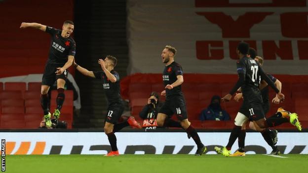 Slavia Prague's players celebrate scoring against Arsenal in the Europa League