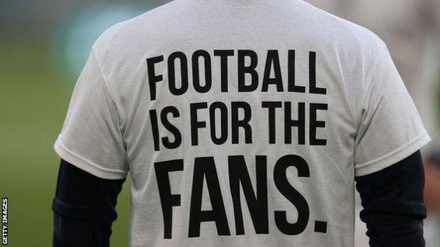 A t-shirt reading football is for the fans