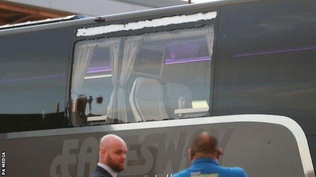 A smashed window on Real Madrid's team bus