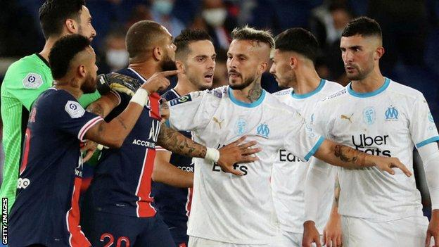 Alvaro Gonzalez and Neymar arguing, with the Brazilian forward pointing his finger at the Marseille player