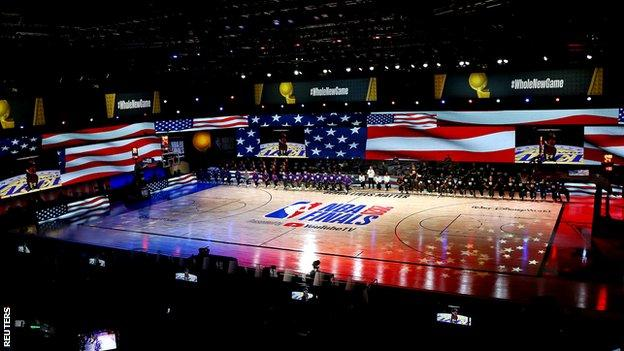 General shot of the Los Angeles Lakers and the Miami Heat taking the knee before the start of the game