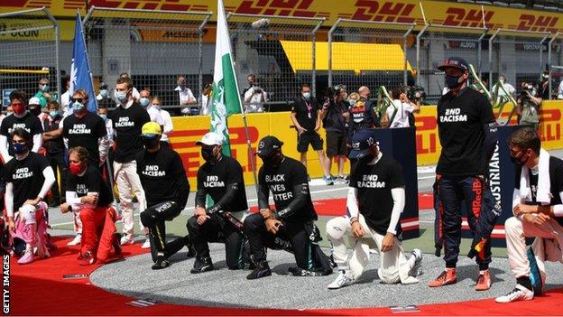 sport Drivers take the knee at the season-opening race in Austria, while six remain standing