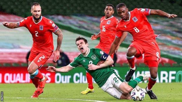 Republic of Ireland captain Seamus Coleman is tackled by Luxembourg's Christopher Martins