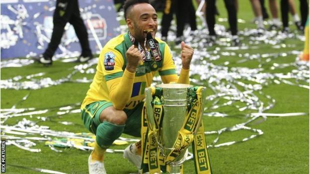 Nathan Redmond celebrates after helping Norwich win promotion