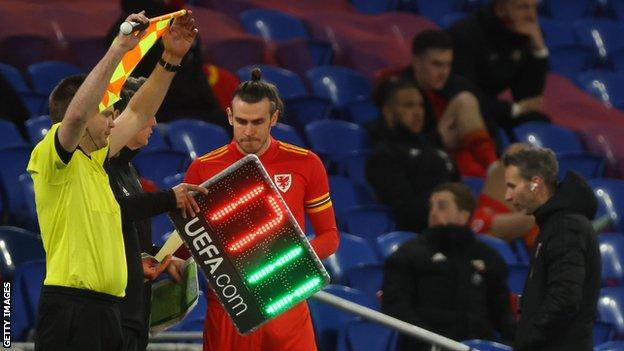 Gareth Bale prepares to come on for Wales