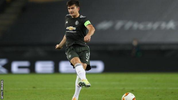 Manchester United's Harry Maguire kicks the ball