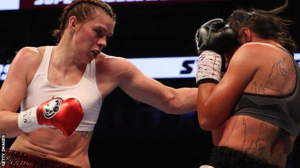 Savannah Marshall throws a punch at an opponent