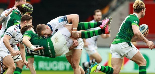 Bristol center Sam Bedlow tackles London Irish center Theo Brophy Clews