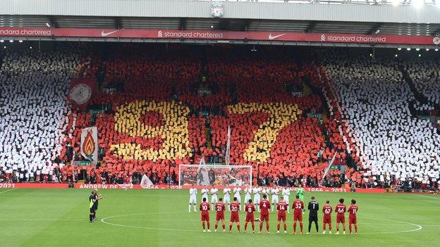 Liverpool fans hold up a 97 mosaic in memory of supporter Andrew Devine