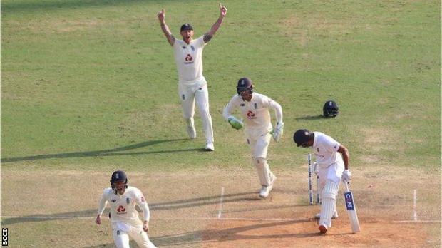 England celebrate Rohit wicket