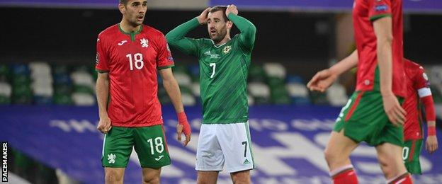 Niall McGinn reacts to a missed chance at Windsor Park
