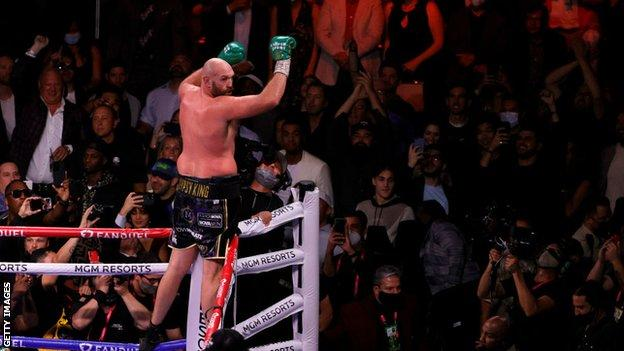 Tyson Fury jumps on the ropes to celebrate
