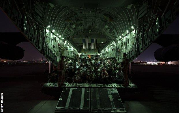 An American military plane prepares to depart Kabul airport carrying evacuees, on 21 August