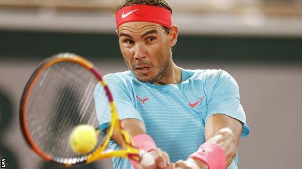 Rafael Nadal returns against Stefano Travaglia