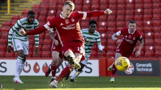 Lewis Ferguson scores a penalty against Celtic