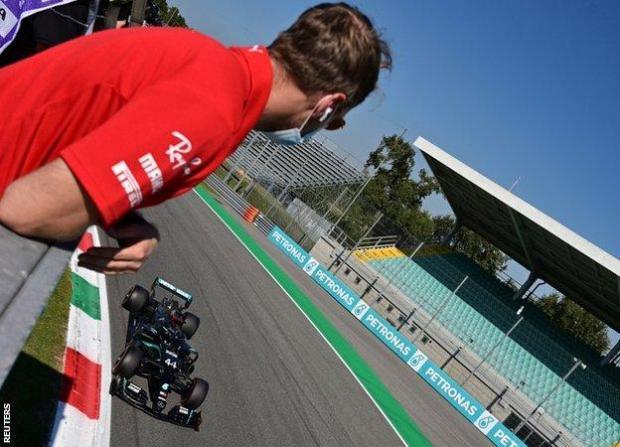 Sebastian Vettel watches Lewis Hamilton cross the line to take pole at Monza