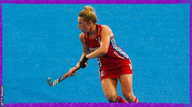 Susannah Townsend playing hockey