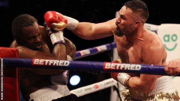 Parker survives knockdown to beat Chisora