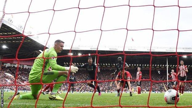 Dean Henderson concedes a goal against Liverpool for Sheffield United
