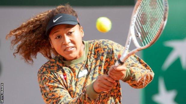 Naomi Osaka playing a shot