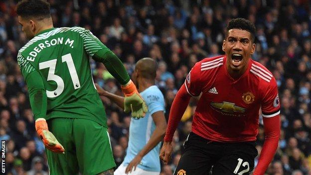 Chris Smalling celebrates scoring Manchester United's winner