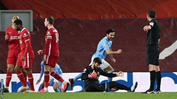 Alisson looks dejected after making an error that led to Ilkay Gundogan putting Manchester City 2-1 up