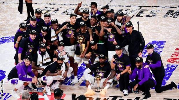 LA Lakers celebrate with the NBA trophy