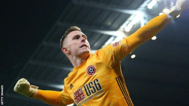 Dean Henderson celebrates while playing for Sheffield United