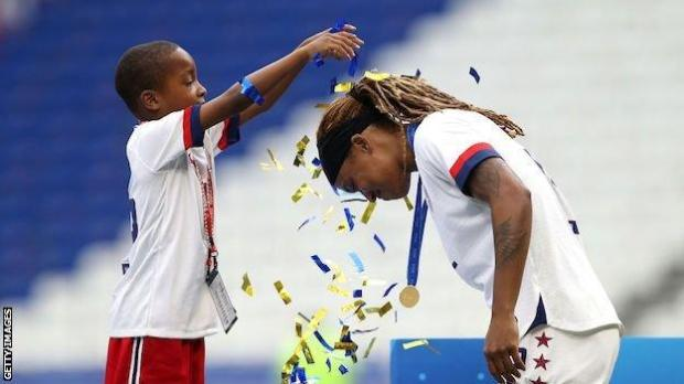 Jessica McDonald has ticker tape sprinkled over her head by son Jeremiah
