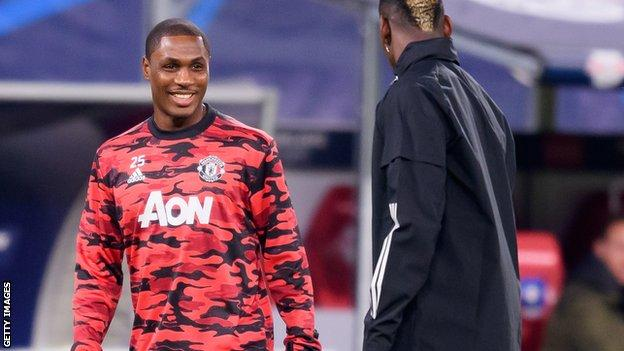 Odion Ighalo with Manchester united Jersey