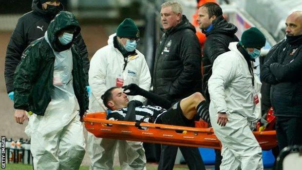 Fabian Schar is carried off the pitch following a knee injury