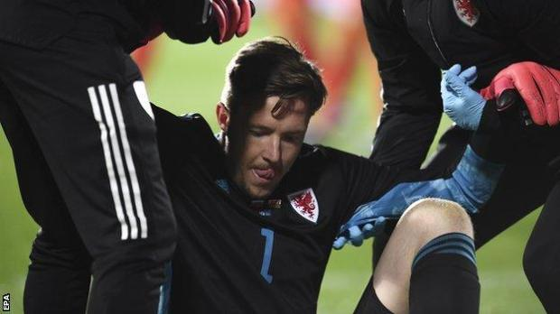 Wales goalkeeper Wayne Hennessey had to be replaced injured after 79 minutes in Sofia
