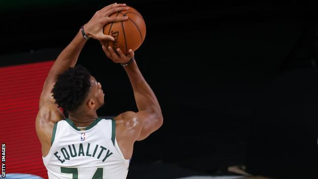 Giannis wears a jersey with the words equality on the back