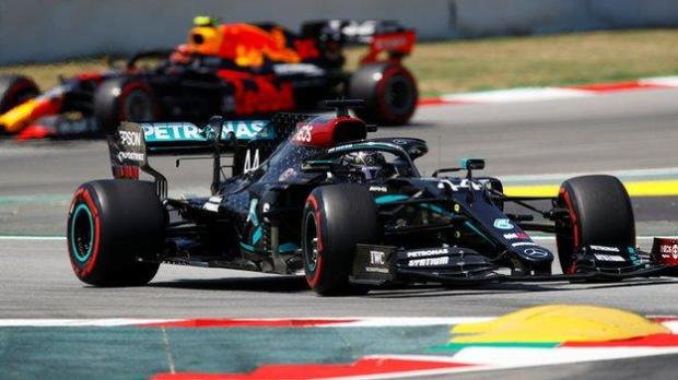 Max Verstappen and Lewis Hamilton on track in Barcelona