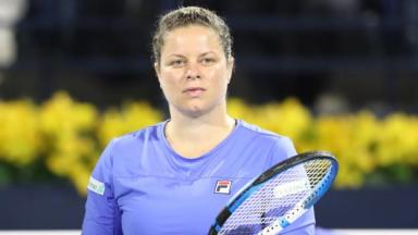 Kim Clijsters: Belgian shines in comeback defeat by Garbine Muguruza