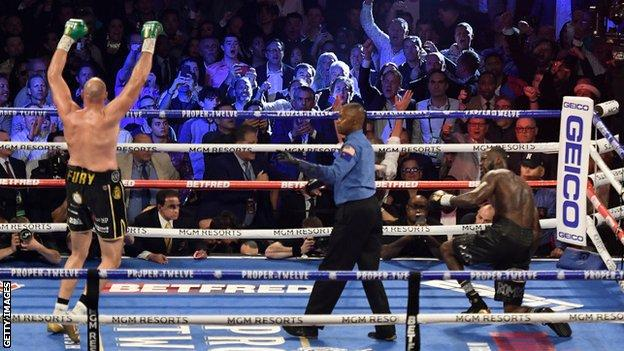 Tyson Fury celebrates after knocking down Deontay Wilder