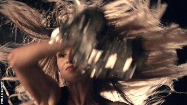 Lacy Thibodeaux-Fields headshot - dancing.
