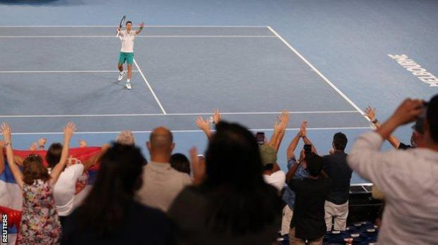 Novak Djokovic celebrates with fans on Rod Laver Arena
