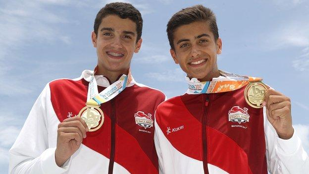 Javier and Joaquin Bello with Commonwealth gold