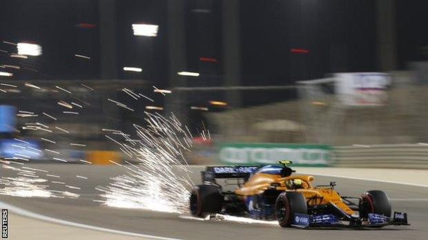 Sparks fly out of the rear of Lando Norris' McLaren