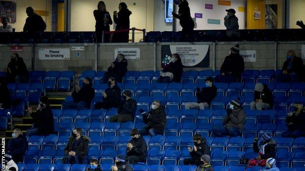 Wycombe fans watching their side's game against Stoke