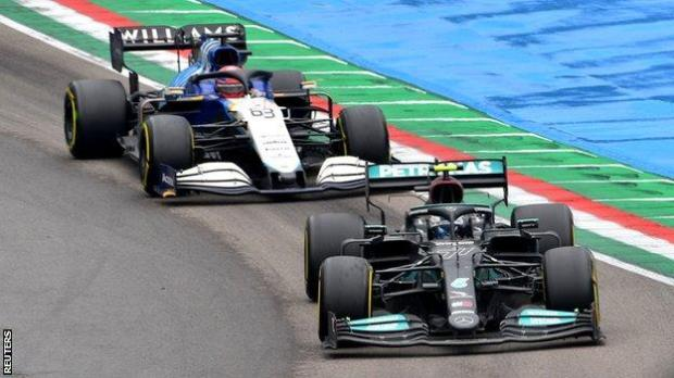 George Russell drives behind Valtteri Bottas