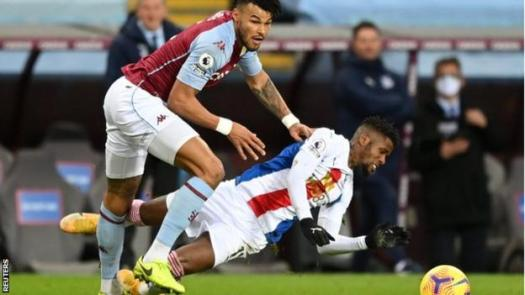 Tyrone Mings fouls Wilfried Zaha in Aston Villa's game with Crystal Palace