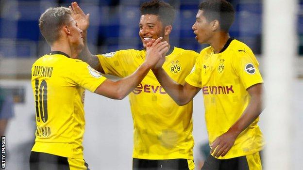 Jude Bellingham (right), celebrates with Jadon Sancho (centre)