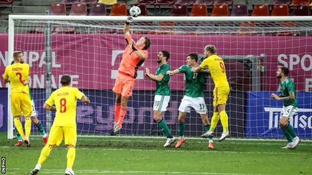 Northern Ireland keeper Bailey Peacock-Farrell makes a save during the 1-1 draw in Romania in September