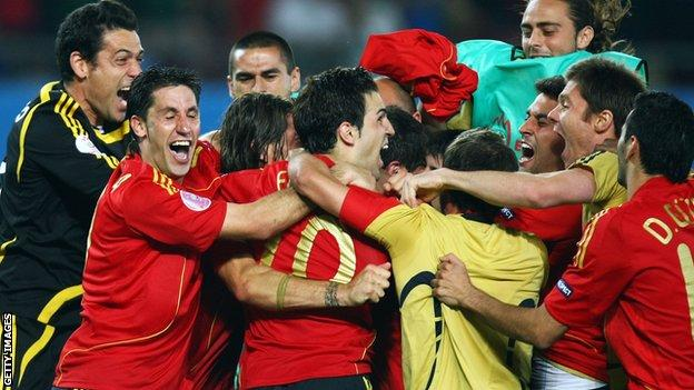 Fabregas and the Spain team celebrate their penalty shootout victory over Italy in 2008