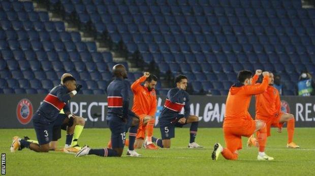 Players take knee