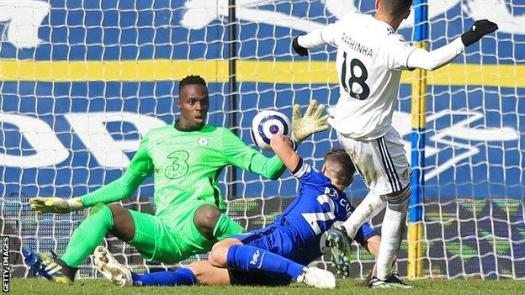 Edouard Mendy (left) saves for Chelsea at Leeds