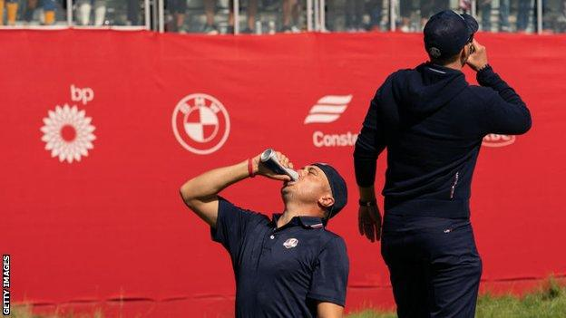 Justin Thomas drinking a beer at the Ryder Cup