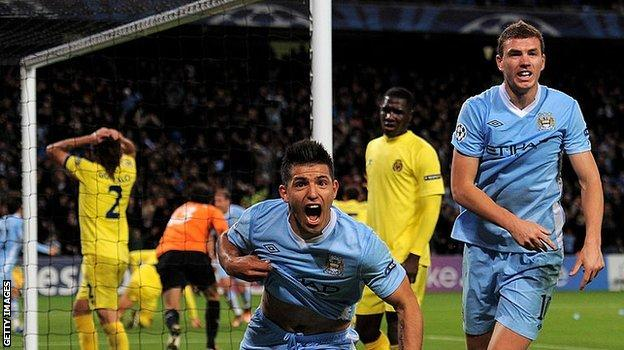 Sergio Aguero celebrates his Champions League debut for Manchester City